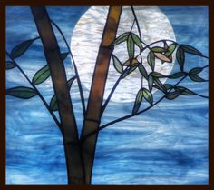 """A cuckoo cries and through a thicket of bamboo the late moon shines.   Basho    """"Bamboo Moon,"""" a layered art-glass hanging panel by Skip Thomsen"""