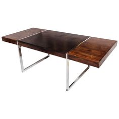 Large Rosewood and Leather Desk | From a unique collection of antique and modern desks and writing tables at https://www.1stdibs.com/furniture/tables/desks-writing-tables/