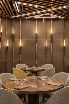 Intimate dining space in the AI restaurant defined with beautiful lighting and copper clad ceiling - Located in the heart of Vienna's Golden Quarter, Gatserelia Designs have developed 'AI Restaurant', an innovative Asian restaurant taking the city by storm with its unique and edgy vibe. #restaurant #interiordesign #vienna #gatsereliadesign #restaurantdesign