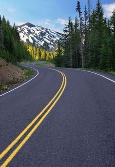 Another road trip dream!  Curving road leading to Mount Bachelor near Bend, Ore. (© Ralph William/Alamy)