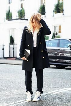 Mija Flatau wearing a pea coat, trousers, adidas sneakers, and a Chanel bag.