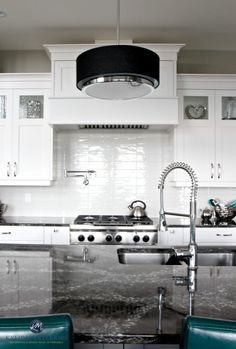White contemporary kitchen with Cambria Ellesmere countertop on island. Off-white subway tile backsplash. Kylie M Interiors Decorating,Design and Online Color Consulting