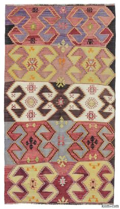 Vintage kilim rug hand-woven in Afyon, located inland from the Aegean coast of Turkey in 1960's. This tribal kilim is in very good condition.