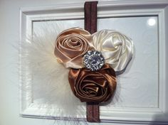 Coffee, nude, ivory satin rosette flowers with jewel center and marabou attached to coffee elastic headband