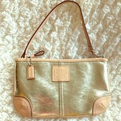 NWOT - COACH Metallic Gold Mini Purse Impeccable COACH with strap that can hook to be worn on shoulder or wrist. Versatile, timeless with a little flash. Coach Bags