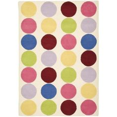 A whimsical dot design and dense, thick pile highlight this New Zealand wool pile handmade rug. This floor rug has an ivory background and displays stunning panel colors of yellow, pink, blue, red and green.