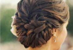"""French braid part way, ending to one side. """"Edge braid"""" (like a herringbone braid but with thicker sections on the edge) all the way to opposite ear. Finish braid tail and pin in a bun."""