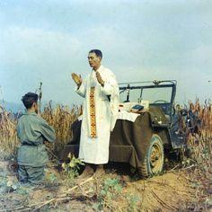 Priest Fr. Kapaun blessing a Korean soldier