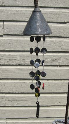 Old funnel and bottle cap wind chime. From The Alley To The Gallery