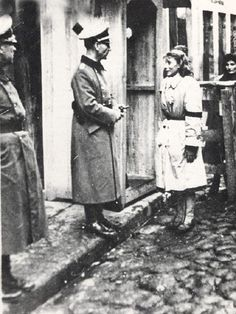 A Jewish woman being investigated by a Gestapo man during an Aktion in the Vilnius ghetto. You can see the terror in her face! How tragic sad this whole situation is!!!