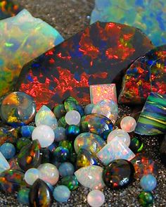 Our Gilson opal comes in many forms including rough, tumbled, chips and cabochons. We occasionally have 2nd quality material as well. Below and to the left are our different opal categories. Please email us if you have any questions or are looking for something we don't carry.