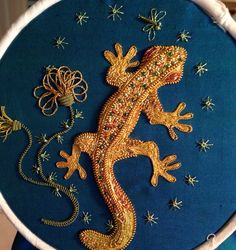 My golden gecko. I think he is finished. Had a huge amount of fun stitching him. Made up this design as I went along. Taken me too long.