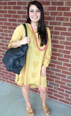 Ansley wearing our new yellow high-low dress, Faire necklace and bangle, and Frye Handbag. Now available at Emma Laura-Graceful Gold located in Ivy Place 2032B Veterans Blvd. Dublin, GA 31021 478-272-2095 www.emmalaura.com Check us out on Facebook at https://www.facebook.com/pages/GRACEFUL-GOLD-JEWELRY-CO/163839008625