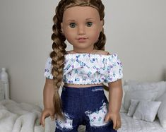 18 inch doll white floral print peasant blouse with distressed denim shorts. Doll not included. Ropa American Girl, American Girl Doll Shoes, Custom American Girl Dolls, American Girl Doll Pictures, American Girl Accessories, American Doll Clothes, Girl Doll Clothes, Doll Clothes Patterns, Barbie Clothes