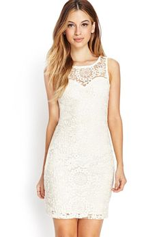 An ethereal piece, this bodycon dress features an embroidered overlay and sheer yoke. A round nec...