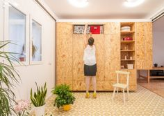 Moving Walls Transform a Tiny Apartment Into a Home Tiny House Layout, House Layouts, Small Space Living, Small Spaces, Madrid Apartment, Plywood Storage, Moving Walls, Wardrobe Room, Tiny Apartments