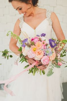 Colorful garden rose + peony bouquet | Photography: Spindle Photography - spindlephotography.com/  Read More: http://www.stylemepretty.com/2014/06/25/summer-wedding-inspiration-with-pewter-accents/