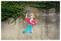 Ilustración de una mujer en un muro exterior. | Quiero más diseño