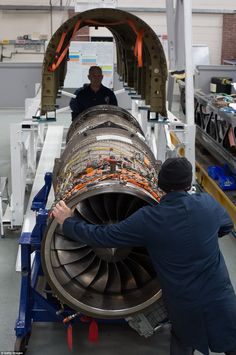 A jet engine is moved underneath a body panel of the Bloodhound vehicle currently taking shape at its design centre in Avonmouth on March 5
