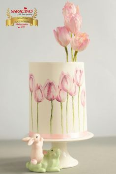 Pink tulips - cake by KatarzynkaYou can find Hand painted cakes and more on our website.Pink tulips - cake by Katarzynka Pretty Cakes, Cute Cakes, Beautiful Cakes, Amazing Cakes, Tulip Cake, Floral Cake, Hand Painted Cakes, Spring Cake, Gateaux Cake