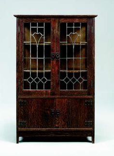 """Stickley's Leaded Glass China Cabinet -- According to Pinner, """"This beautiful and dramatic Gustav Stickley china cabinet was designed by LaMont Warner, perhaps one of the greatest American Arts & Crafts Designers."""""""