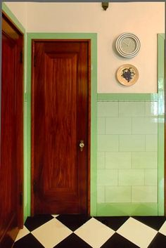 Art Deco Vitrolite kitchen tiles & door.  Vitrolite was made not 5 miles from my home, but it's no longer available.  It was a manufactured rolled glass product considered very desirable for its ease of cleaning and sanitary properties.