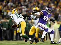 Eddie Lacy #27 of the Green Bay Packers ties up Anthony Barr #55 of the Minnesota Vikings as quarterback Aaron Rodgers #12 of the Green Bay Packers scrambles with the ball during the third quarter of the game on November 22, 2015 at TCF Bank Stadium in Minneapolis, Minnesota. The Packers defeated the Vikings 30-13. (Nov. 21, 2015 - Source: Hannah Foslien/Getty Images North America)