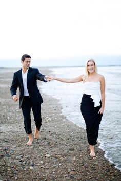 I like the more formal outfits with bare feet at the beach - a bit unusual for engagement photos!