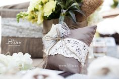 Ring pillow with lace  The 1st Rustic Wedding in Vietnam Designed and Organized by Bliss Wedding Planner See more at: http://blissvn.com/en/Gallery/Album/Timeless-Charm  Trang trí tiệc cưới theo phong cách Rustic bởi Bliss Wedding Planner