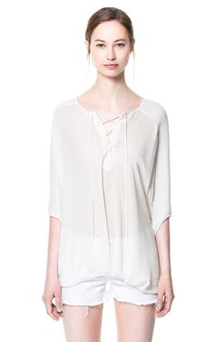 White lace up shirt.