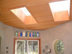 Mayne Island Cob House - I like the bottle idea above the door.  The skylight drop downs are also fairly amazing!
