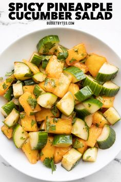 This Spicy Pineapple Cucumber Salad is the perfect mix of salty, sweet, and spicy, making it an addictive summer treat. BudgetBytes.com Spicy Recipes, Vegetable Recipes, Salad Recipes, Vegetarian Recipes, Healthy Recipes, Cheap Recipes, Appetizer Recipes, Cooking Recipes, Easy Orange Chicken