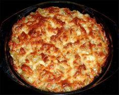 Фото к рецепту: Запеканка из макарон с курицей и грибами.