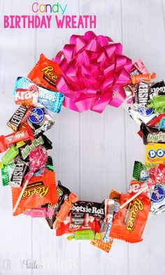 DIY Candy Birthday Wreath this is what i need to do because its cheaper than a pinnata and it does not have that much candy on it and it does not cost that much just get 1 bag of candy go to a Craft store such as Hobby Lobby or Hancock Fabrics and by one of the wreath makers and put it together