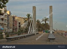 Calella, Spain - July Footbridge In The Center Of Calella Evening. City On The Costa Brava - A Popular Holiday Destination Of… All European Countries, Popular Holiday Destinations, July 11, Costa, Photo Editing, Spain, Royalty Free Stock Photos, Country, Pictures