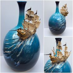 """Ship on a bottle. 13"""" tall thrown bottle and modelled ship from white earthenware clay. Masts sails and pennants from wood cloth and paper. The blue glaze on the bottle has a mother of pearl lustre finish over the ships wake and there is a skull and crossed cutlasses on one of the sails. This item is for sail ….I mean sale :-) at earthwoolfire.etsy.com"""