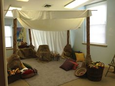 Timeless Truth Tent:  Carpet tubes and muslin tent, baskets of fake fruit and cloth, pillows, burlap.