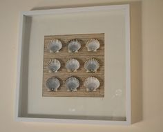 Place your favorite shells you found at #CarolinaBeach in a shadowbox frame for an easy #DIY project.