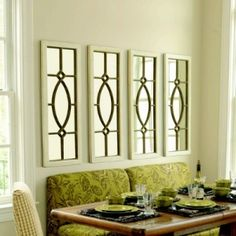 Four mirrors for the empty wall in our family room. Decorating a large wall space is tricky. by jolene