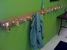 What to do with all of Andy's old trophies...  Love this coat rack idea and the cake topper idea on the blogspot...