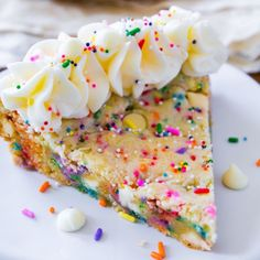 By far the BEST cookie cake in the world. And it's full of sprinkles, white chocolate, and topped with vanilla frosting!