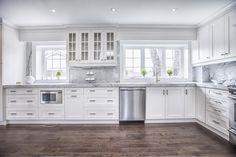 White kitchen wood floors grey marble stainless appliances