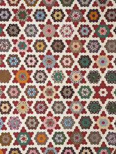Paper-template pieced hexagons are pieced together to form a tessellated pattern of Stars and Rosettes in this eye-catching quilt top from about 1860-1880. From the collections of the Charleston Museum.