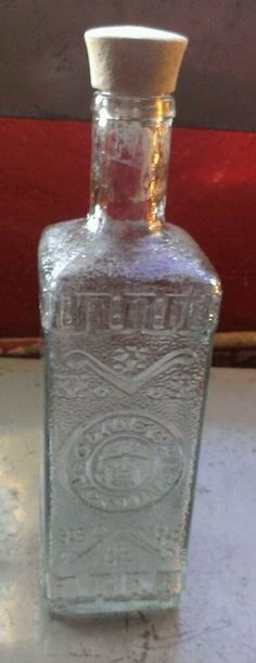 Empty OLMECA TEQUILA BOTTLE  EXCELLENT CONDITION  JALISCO MEXICO clear glass
