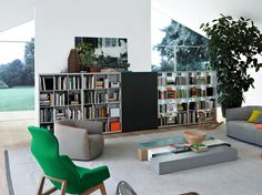 Wall-mounted modular wooden storage wall WALL SYSTEM - POLIFORM    Wall System allows for a wide range of design solutions for a library, entertainment center of the most sophisticated wall unit. The system is completely freestanding and adapts to all architectural environments. —