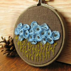 Blue and Brown Floral Embroidery Hoop Wall Decor.  @Connie Tate - I think this would look good in my house. you might have to teach me :)