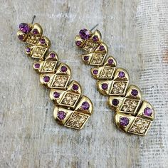 Nanita    These simple yet chic earrings are a statement accessory made for all year wear, beautified with subtle purple and gold stones.