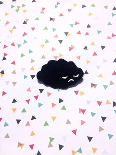 This listing is for 1 unique handmade item. It is a sad, black cloud. It measures about 2 inches wide. Item is made with rigid felt, paint, lapel pin and glue. He is very sad, and looking for a forever home.
