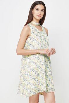 Sleeveless A-line dress with an all-over dainty floral print and a V-neckline that has a choker tie-up.