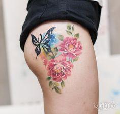 Elegant floral thigh piece by Tattooist River